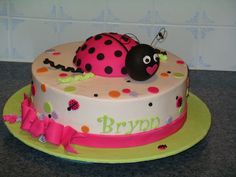 Ladybugged - First birthday cake for a little girl using sour cream vanilla w/strawberry filling.  Ladybug body is strawberry cake (1/2 of a ball cake set) w/fondant head and decorations. Matched colors to party napkin.