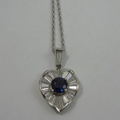 """Heart Shaped Sapphire and Diamond Pendant Set in Platinum on a 16"""" Chain. $2,150"""