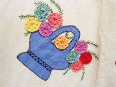 Vintage Basket Quilt with YoYo flowers, note the YoYos are attached with embroidery french knots....how cute is that?