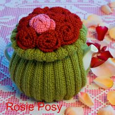 Knit cosy with crocheted flowers