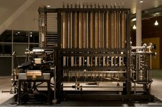 A copy of Charles Babbage's difference engine, originally designed in 1854, was the first mechanical calculator.