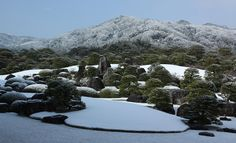 This is the Adachi Museum's famous karesansui or'Dry Landscape Garden' seen in winter. Note the use of shakkei or'borrowed scenery' from the mountains of Shimane Prefecture in the background.