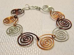 wire links for bracelet | Spiral Link Wire Bracelet. I have lots of colors of wire to do this ...