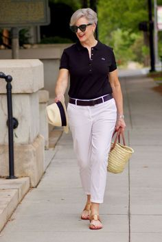 a Lacoste polo is modern french style at it's best. classic and iconic i've had at least one Lacoste polo at my drawer since a teenager. 60 Fashion, Fashion For Women Over 40, Black Women Fashion, Plus Size Fashion, Fashion Outfits, Fashion Trends, Lolita Fashion, Fashion Boots, White Chinos