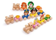 """Geburtstagszug """"Gesichter"""". Dekorativer Holzzug, der sich jedem Geburtstagstisch anpasst. Ob Clown oder Pirat, bei diesem Geburtstag fehlt niemand. Die verschiedenen Waggons können beliebig variiert werden."""