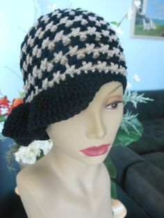 Hand crocheted alternating beige and black  hat with side ruffle