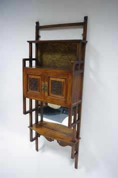 Anglo Japanese wall cabinet in the manner of E. W. Godwin.