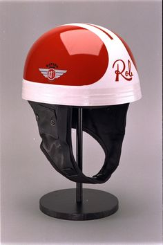 Davida Helmets. Type: racing-series. Style: Racing Series - Rob Bron. Product Code:60703. This design is an interpretation of the helmet design used by this racer,  created by Davida in direct association with and approved by Rob Bron. An individual racers design would change and evolve throughout their racing career and so this is an example of just one of the helmet designs he used.    Davida Racing Series on our Classic Helmet does not conform to any current helmet safety standards.