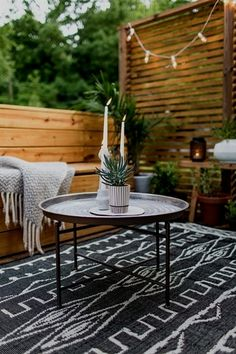 I love the way this patio looks, especially the rug and coffee table, both from At Home (which has a store in CO). She gives a great explanation of how she achieved this look. An Outdoor Revamp with At Home : The Final Look Indoor Outdoor, Outdoor Carpet, Outdoor Rooms, Outdoor Tables, Outdoor Living, Outdoor Decor, Cheap Outdoor Rugs, Outdoor Patios, Outdoor Cushions