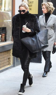 Olivia Palermo black coat, leather pants, handbag and sneakers for winter.