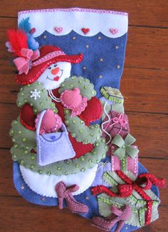 Bucilla Shopping Spree Completed by MissingSockStitchery on Etsy Christmas Candy Crafts, Felt Christmas Stockings, Felt Stocking, Homemade Christmas Decorations, Stocking Tree, Felt Decorations, Snowman Crafts, Christmas Hat, Felt Crafts