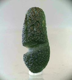 "Possible the only known ""stretch"" moldavite tektite.  Weighs 15.4 gr. and measures 47.19 X 19.5 X 13.9 mm. Chlum nad Malsi, Czech Republic.  Photo from www.tektitesource.com"