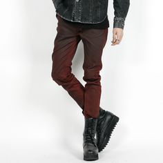 Oil wash slim fit jeans. These jeans have an oil wash that gives them a vintage, grungy finish. With their low rise, button-and-zip fly, and slim fit, these jeans are ideal for street wear paired with a biker jacket and a vintage print t-shirt. Wear these jeans tucked into boots to complete the look.