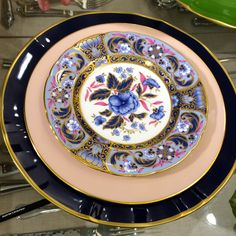 Mixing Patterns: Putting a new spin on heirloom china.  Charger: Anna Weatherley in Cobalt. Dinner plate: Lenox Caribbee, c.1953. Salad plate: Royal Crown Derby, Blue Camilia.  (Charger and Salad plate available at Neiman Marcus Gift Gallery, Dallas, TX.)