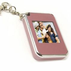 Key Chain LCD Digital Frame The Key Chain Digital Photo Frame is so small and exquisite, you can take it anywhere. The digital photo frame provides internal storage space to access external memory cards, and the built in capacity can hold up to Digital Photo Frame, China, Cool Gadgets, Key Chain, Silver, Accessories, Electronics, Space, Storage