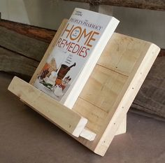 Reclaimed and repurposed pallet wood cookbook, tablet or iPad holder. Great for holding your cookbook or tablet while you are cooking. Very sturdy construction. Completely natural- no stain, no sealer which allows you to use it as is or paint/stain it to match your own decor. Approximate