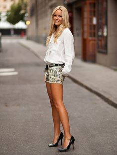 Classic black pumps with snake print shorts and button down shirt