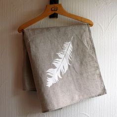 Linen teatowel with ethnic feather by Unni Strand.