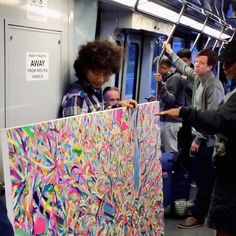 { Article: This Week in Pictures } Joyful painting riding San Francisco's Muni line