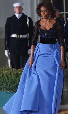The First Lady stunned in a Carolina Herrera ball gown to greet French President François Hollande in February 2014. © Getty Images