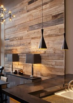 Reclaimed wood feature wall by Madera http://www.maderawoodworking.com/