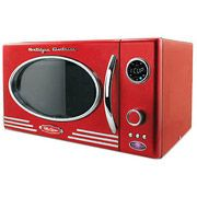 Retro-style microwave with dial controls and twelve pre-programmed settings. Product: MicrowaveConstruction Material: Metal and glassColor: Red, chrome and blackFeatures: Dial controls have 12 pre-programmed settingsDimensions: 11 H x 19 W x 14 D Red Kitchen, Vintage Kitchen, Kitchen Ideas, Kitchen Stuff, Kitchen Decor, Diner Kitchen, Turquoise Kitchen, 1950s Kitchen, Happy Kitchen