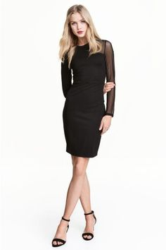 Fitted dress in jersey with transparent mesh sections, long sleeves and a seam at the waist.