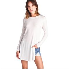 Side slit ribbed white top Side Slit white long sleeve top. SIZE LARGE  See additional listings for more sizes! (S,M,L)   Super cute with jeans or shorts!  April Spirit Tops Tees - Long Sleeve