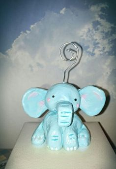The cute elephant from modurit. You can use it for your favourite photo. Lucky elephant will hold your memories. Diy it easy... Also from fimo.