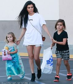 Princess: Penelope Disick dressed in a Elsa from Frozen costume on an outing with Kourtney Kardashian and Mason Disick in Calabasas on Monday