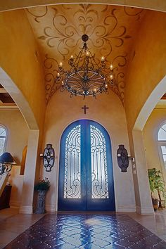 Mediterranean home with hand-painted groin vault ceiling...