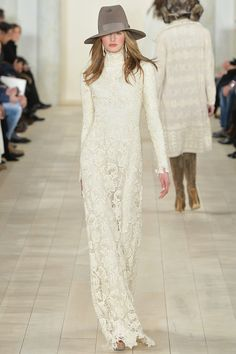 The all-American girl grows up with this long-sleeved romantic, floor-length lace sweeper. -