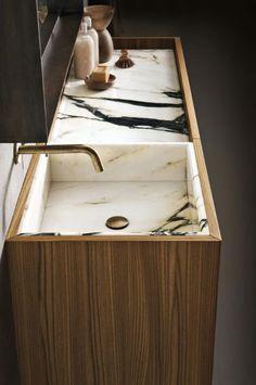Lavabo diseñado en mármol con madera
