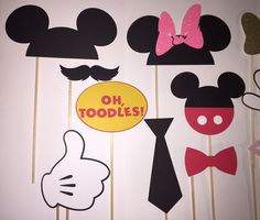 These photo booth props will be a hit at any party. Whats included:  15 pieces...  1 Minnie Mouse ears with glitter bow 2 Pair of Minnie Mouse glasses 1 Minnie Mouse glitter bow 1 pair of lips 1 Mickey Mouse ears 3 Mickey Mouse hands 1 Pair of Mickey Mouse glasses 1 Pair of goofy glasses 1 Mickey Mouse pants head 1 Bow tie 1 Tie 1 Oh Toodles These props are made using card stock. The colors and characters can be changed to fit your needs. Simply contact me and I will customize it for you…