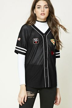 """A semi-sheer honeycomb knit baseball jersey featuring a """"Mixed Emotions"""" back embroidery, various patches including pizza, a broken heart and """"K, Whatever"""", a button front, short sleeves with varsity stripes, and a V-neckline."""