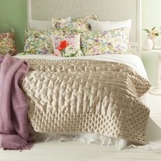 beautiful antique-like shiny quilt matched perfectly with lilacs and flowery patterns