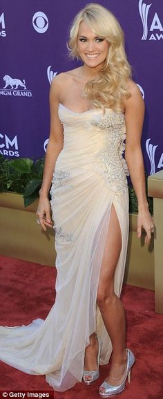 A Dress I though Cristin would like,  a strapless cream gown by Abed Mahfouz that was embellished with beads and boasted an asymmetric cut.    Read more: http://www.dailymail.co.uk/tvshowbiz/article-2123797/ACM-Awards-2012-Taylor-Swift-Miranda-Lambert-Carrie-Underwood-best-dressed-red-carpet.html#ixzz1rfkQuZml