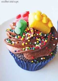 Who said movie night had to be ordinary? Mix things up by shaking on some colorful sprinkles onto delicious chocolate cupcakes. Plus, the whole family will love the building block decorations!