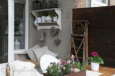 Spring porch ~ I just picked up an old wooden ladder like this one for two dollar.