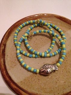 A personal favorite from my Etsy shop https://www.etsy.com/listing/230524850/yellow-and-blue-fish-beaded-bracelet