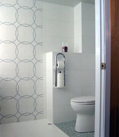 That cool toilet paper holder is actually a grab bar. It's fastened to solid wood backing beneath the wall tile and easily supports a person's weight.    Read more: http://www.houselogic.com/photos/universal-design/universal-design-quiz/slide/a-minimalist-space-with-maximum-safety/#ixzz2QLHMMh8N