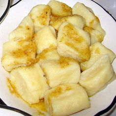 This recipe for Polish potato dumplings or kopytka is made with cooked mashed potatoes. They can be served with butter or with roasted meat dtrippings.