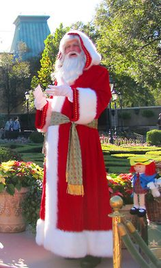 France - Pere Noel in his long hooded red robe.  In France, the children place there shoes by the fire place in hopes that le Pere Noel/Father Christmas  will place gifts for them.