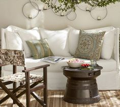 PB: Hampton Slipcovered Outdoor Sofa...Have an old metal daybed I have to get by with for a while in the family room...love this idea!