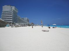 Talcum powder like stand stretches for miles on an uncrowded beautiful day in Cancun.