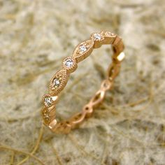Custom Diamond Shield Round Wedding Ring in 14K Rose Gold with Milgrain Detailing or Antiquing. $775.00, via Etsy.