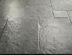 Solid Limestone Tiles with hand-cut edge, partially bush hammered surface and consumed natural undulated, time worn finish. Available in a very homogeneous Grey