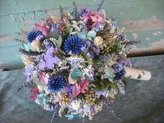 Stunning dried flower Bride's bouquet with Birch handle in shades of blue and pink.  Converts into a topiary centerpiece for your head table