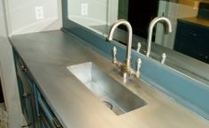 Vanity zinc countertop with an integral zinc trough sink.