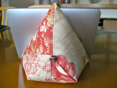 iPad / e-book reader beanbag. Works well as a stand for the iPad on a flat surface such as a table. I use it to read recipes. For this purpose using oilcloth rather than plain cotton would have worked better.